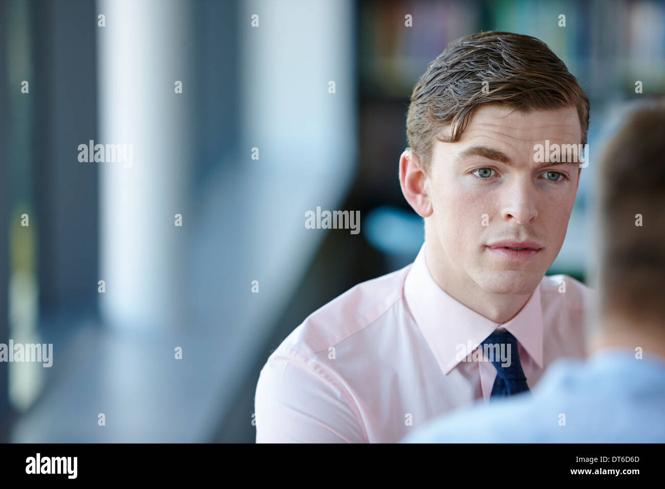 Young businessman in shirt and tie - Stock Image