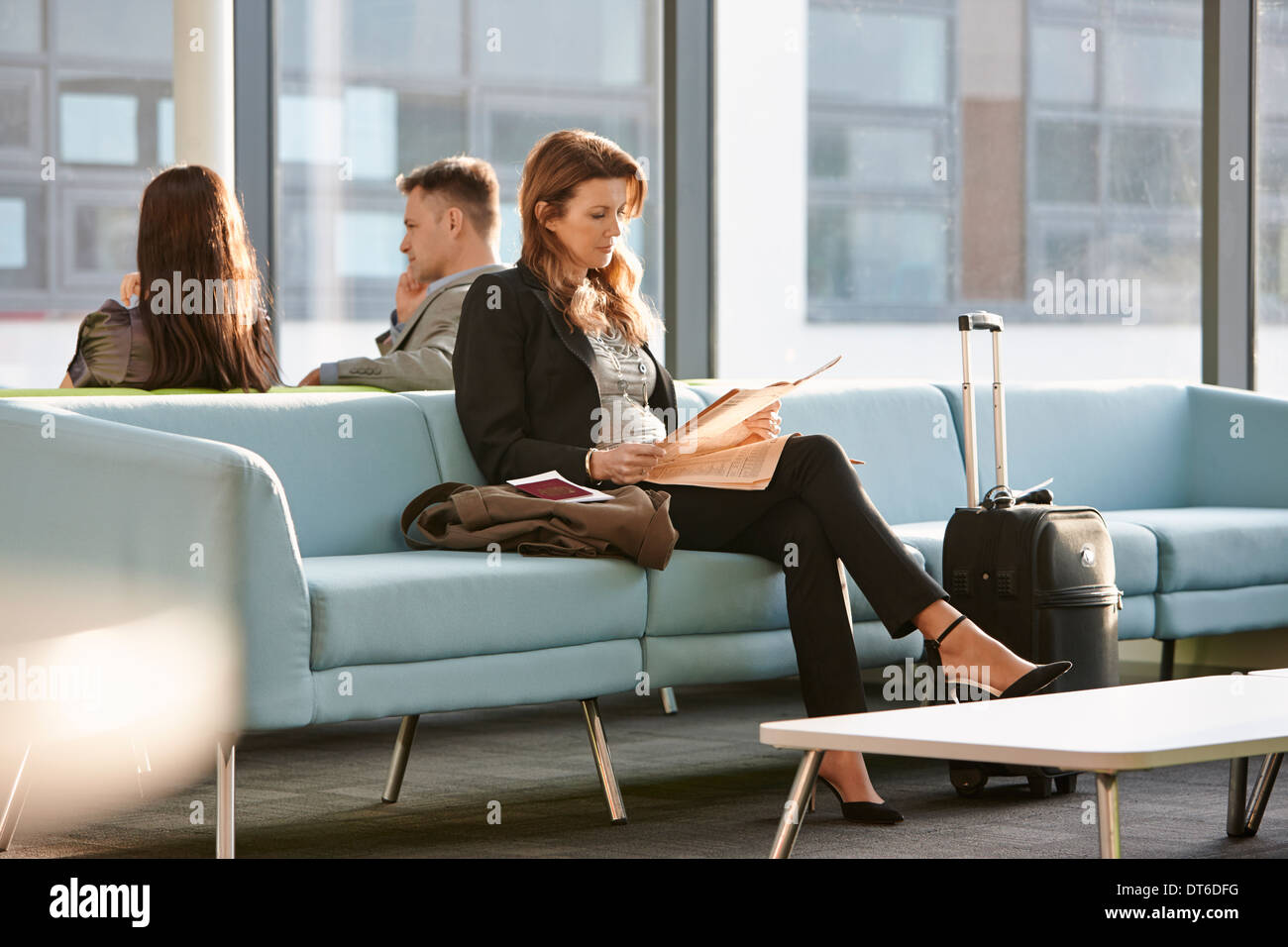 Businesswoman in departure lounge - Stock Image
