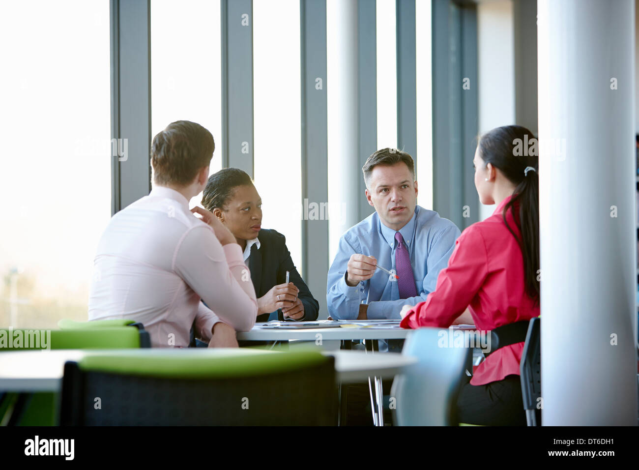 Business colleagues in meeting - Stock Image