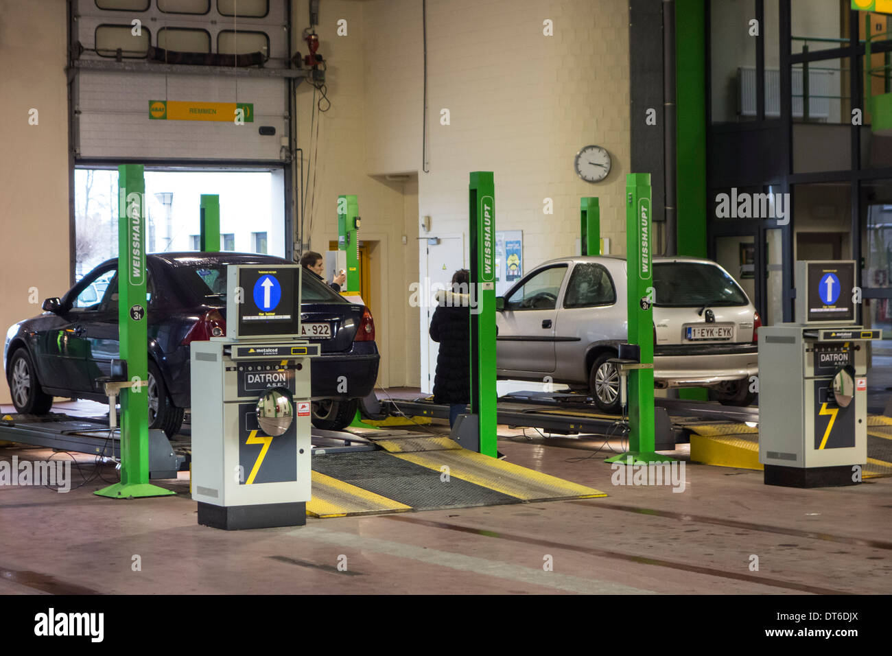 Inspection of cars in MOT testing centre for a yearly motor vehicle inspection - Stock Image