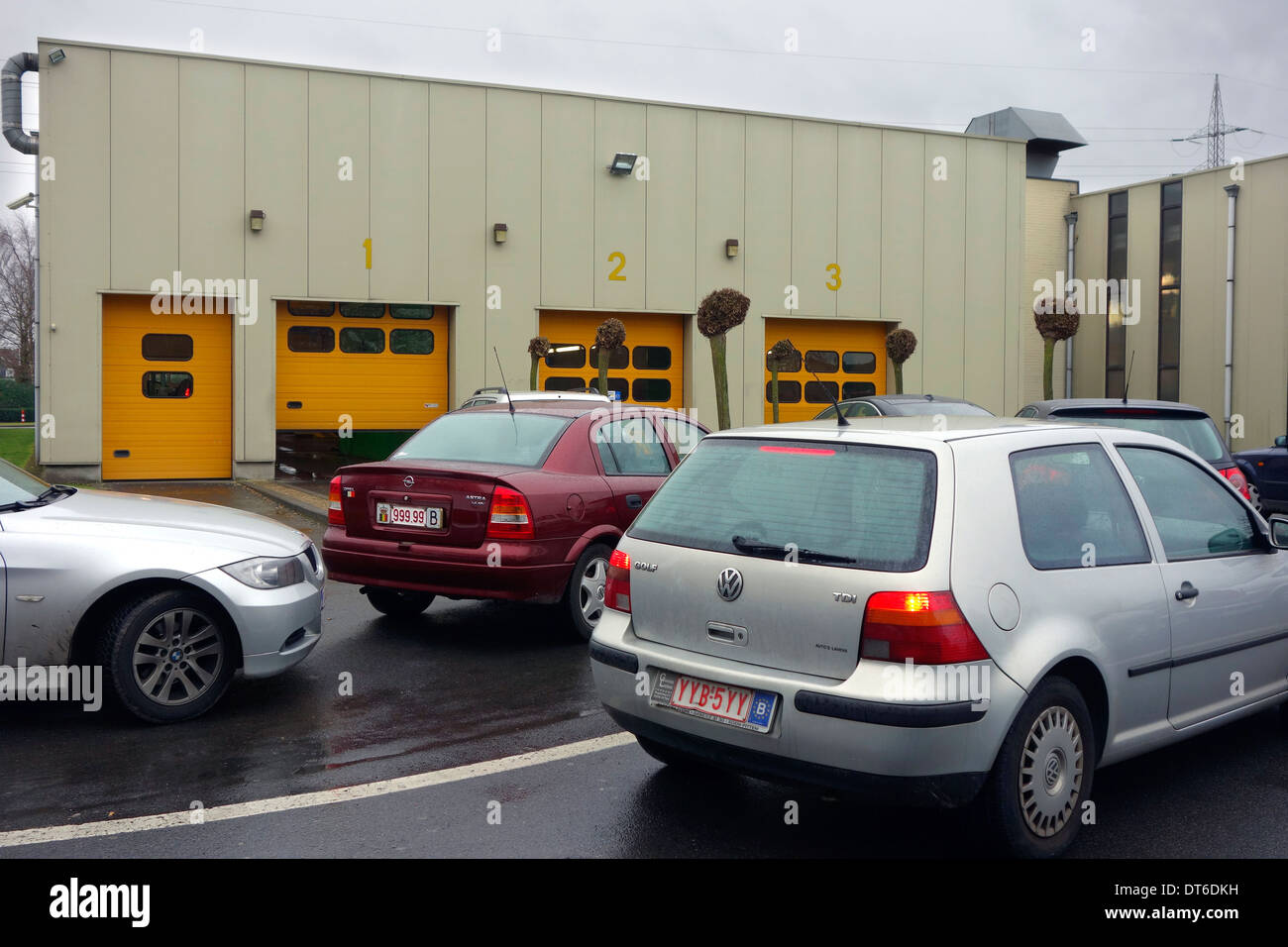Belgian cars queuing in front of SBAT / MOT testing centre for a yearly motor vehicle inspection in Belgium - Stock Image