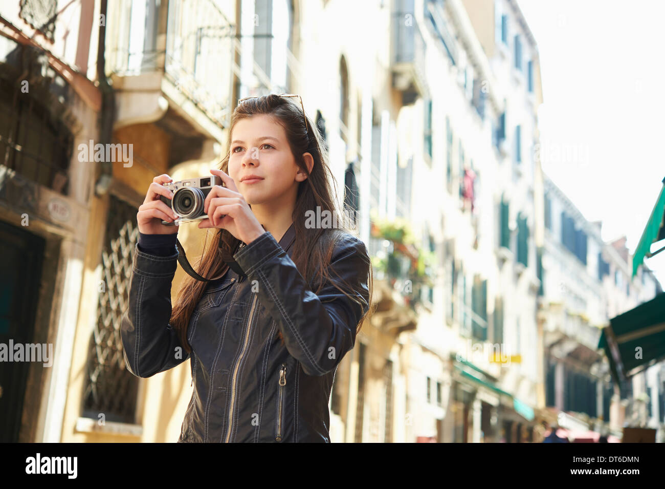 Girl exploring with camera, Venice, Italy - Stock Image