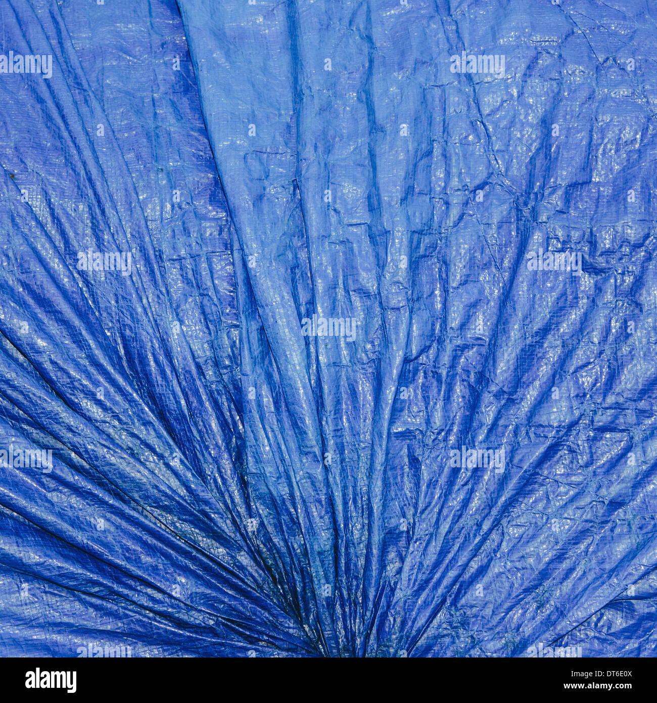 a blue tarpaulin covering gathered and tied as a covering over commercial fishing nets, Fisherman's Terminal, Seattle - Stock Image