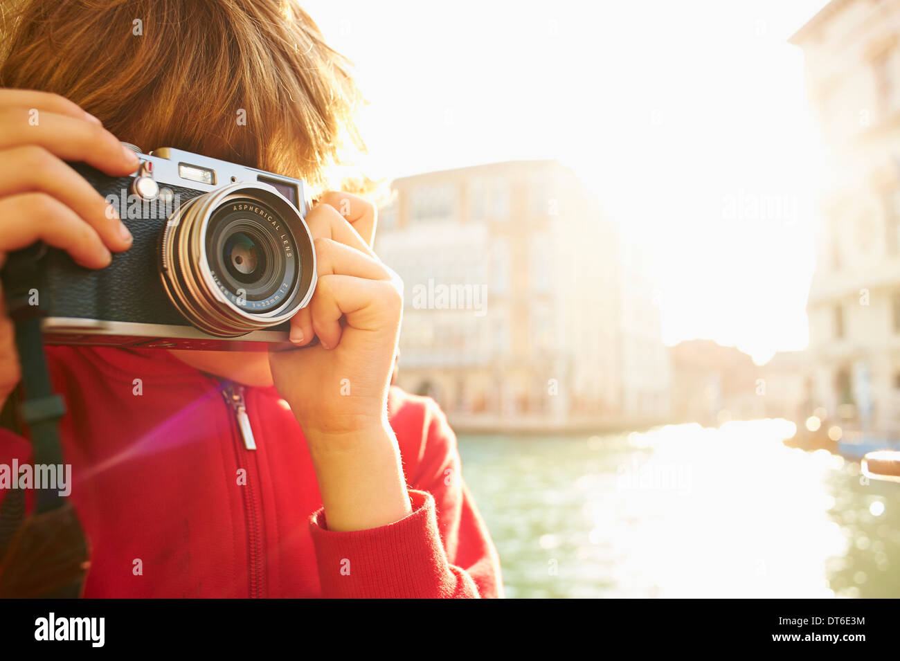 Young boy exploring with camera, Venice, Italy - Stock Image