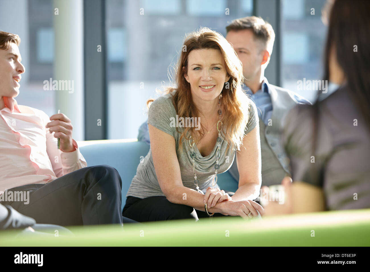 Portrait of business colleagues in meeting - Stock Image