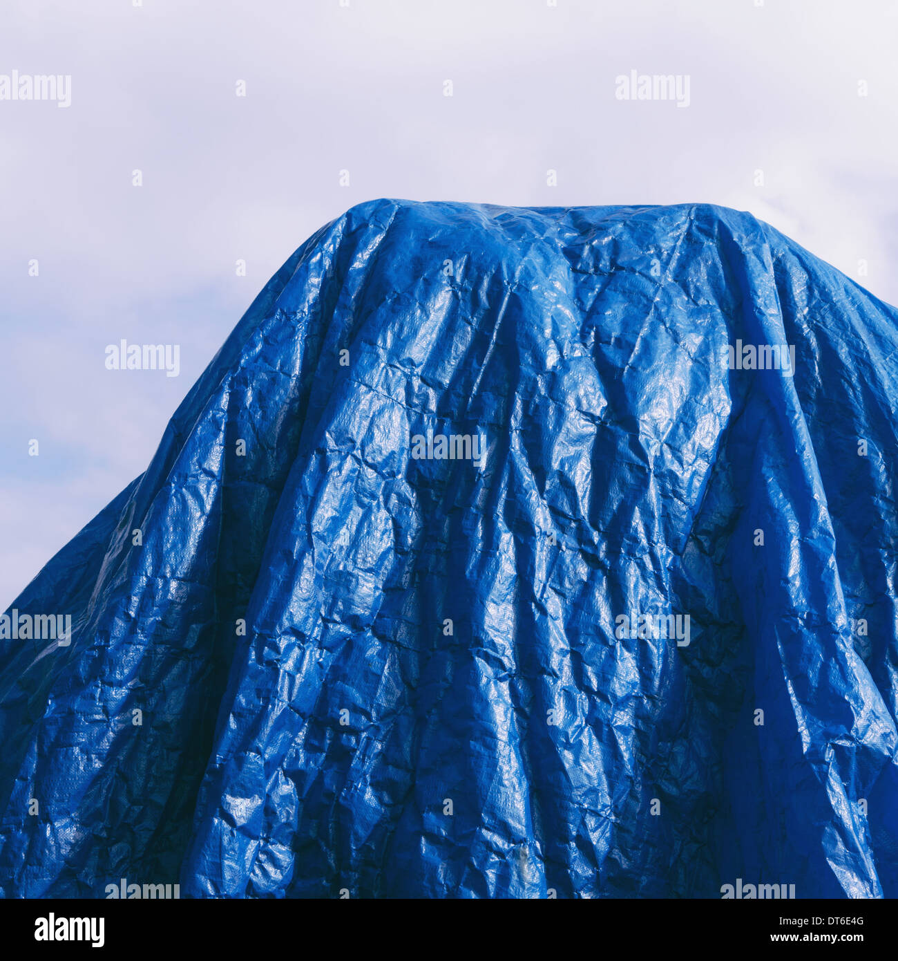 A blue tarpaulin, draped over commercial fishing nets, Fisherman's Terminal, Seattle - Stock Image
