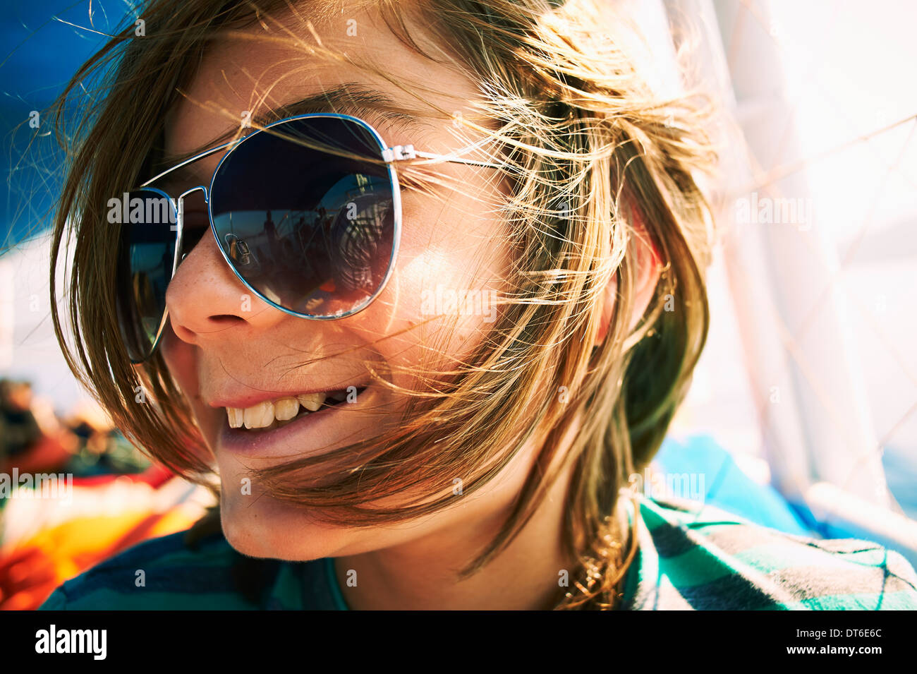 Close up candid portrait of boy in sunglasses - Stock Image