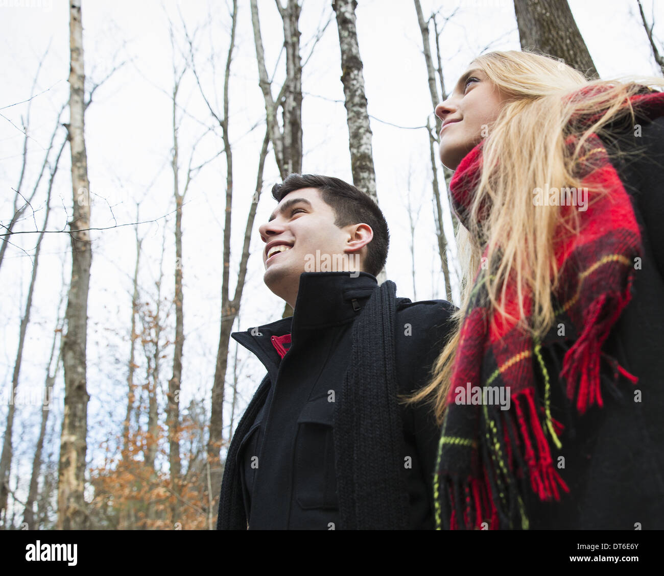 A couple in winter coats outdoors on a winter's day. - Stock Image