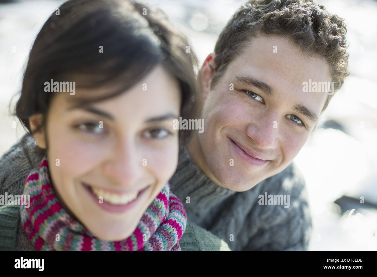 Close up of two people, man and woman, a couple outdoors on a winter day. - Stock Image