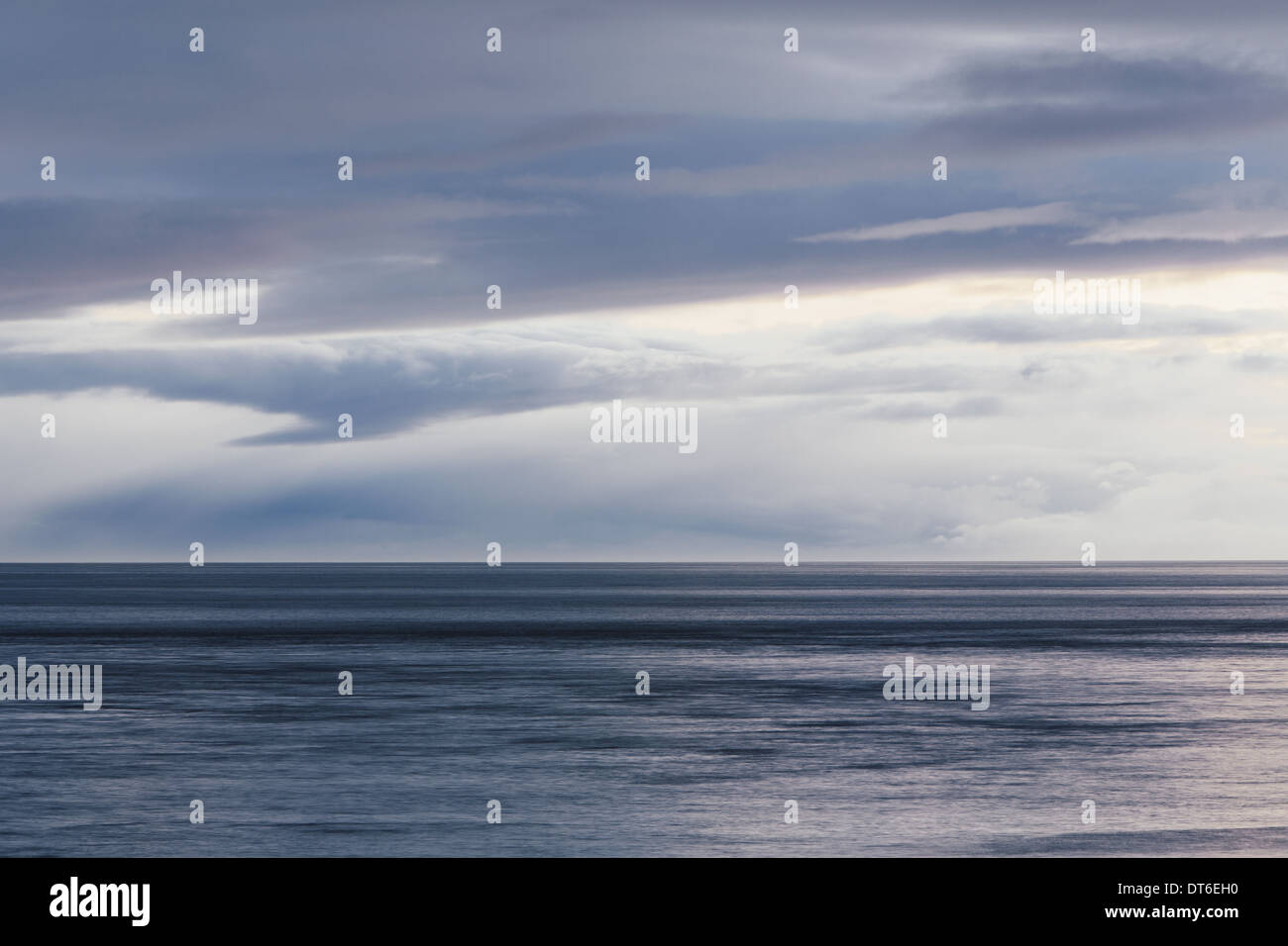 The sea and sky over Puget Sound in Washington, USA. The horizon with light cloud layers above. - Stock Image