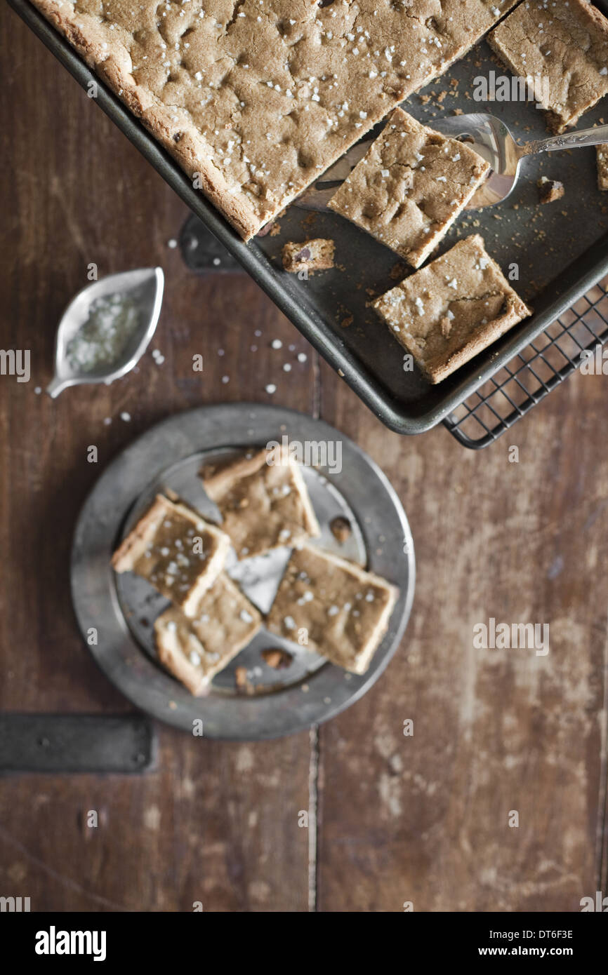 Overhead view. A tray bake, cake or biscuits cut into squares. Organic food. - Stock Image
