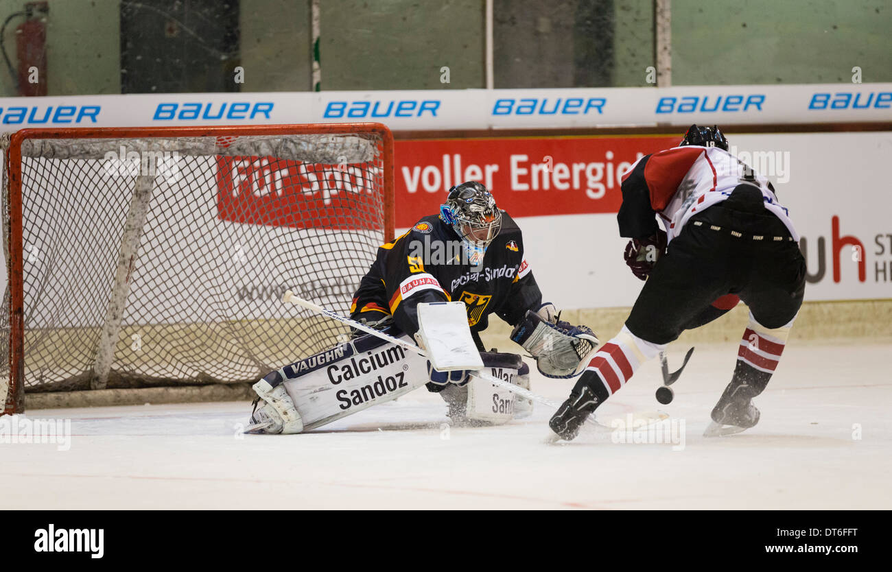 German international ice hockey goalie Timo Pielmeier, left, plays for the German national team against Latvia. - Stock Image