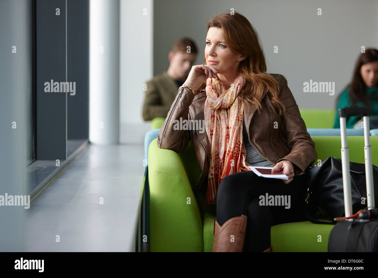 Mature woman in departure lounge - Stock Image