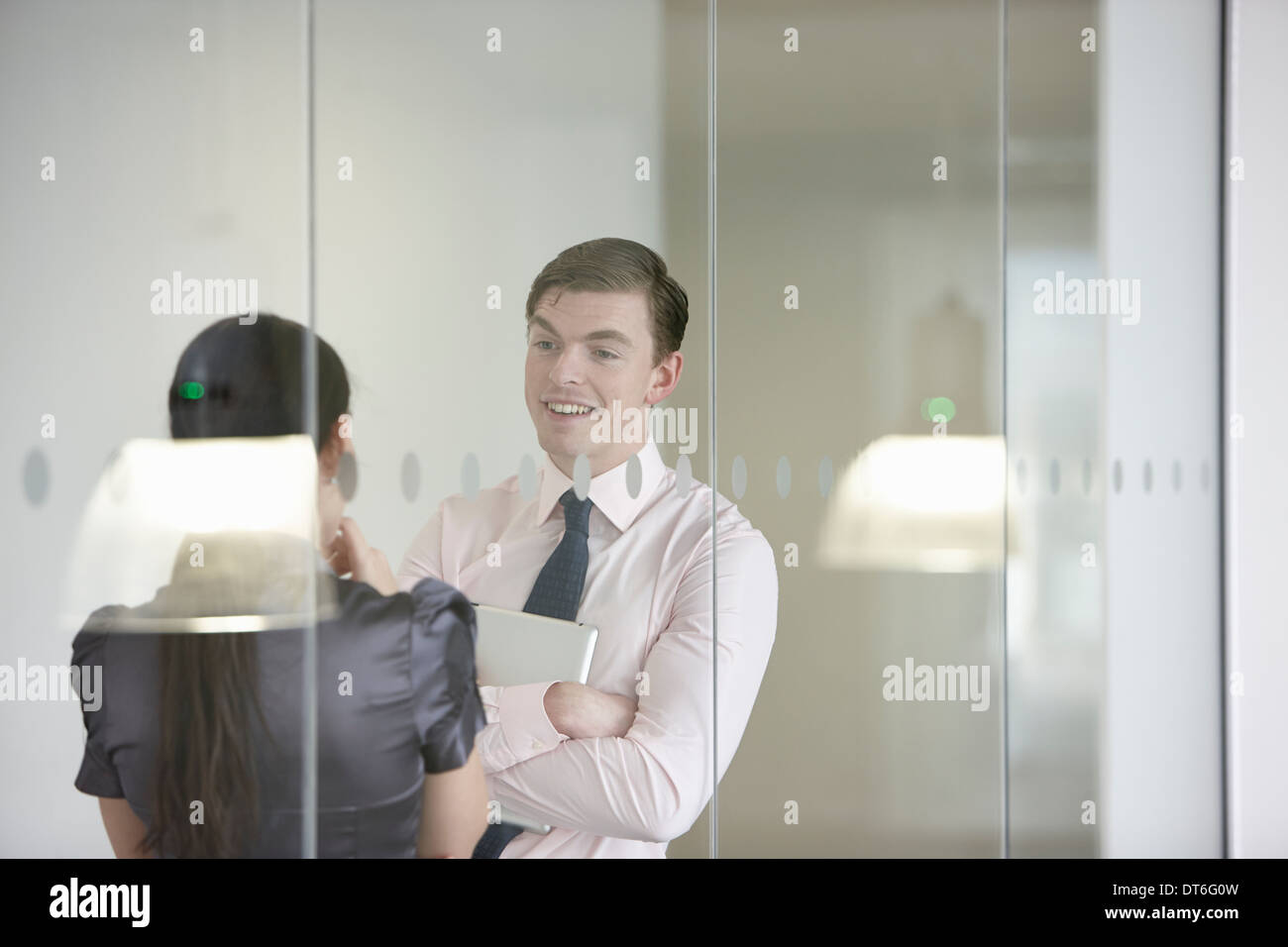 Business colleagues in discussion through glass Stock Photo