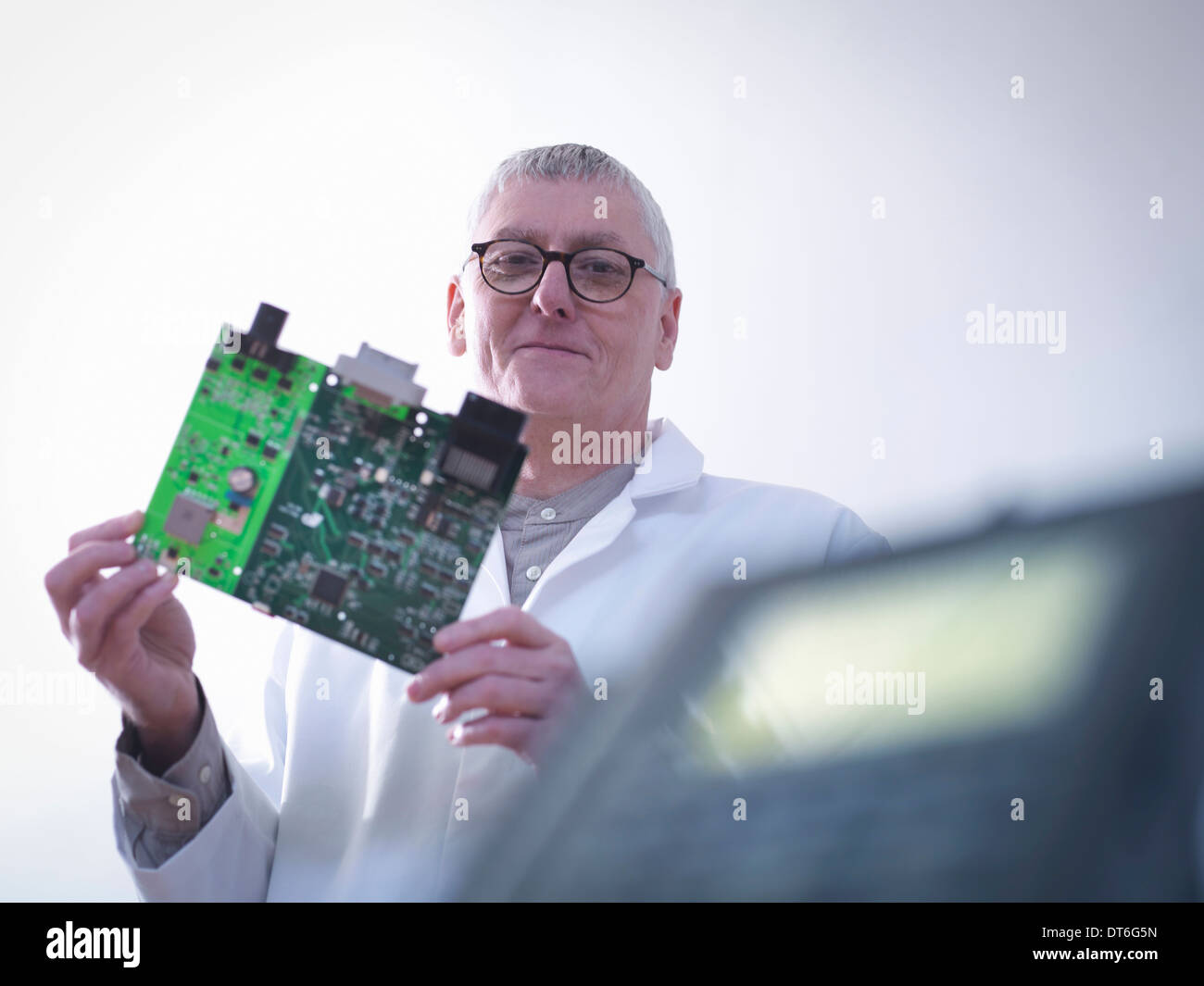 Portrait of engineer designing electronic circuitry for automotive use - Stock Image