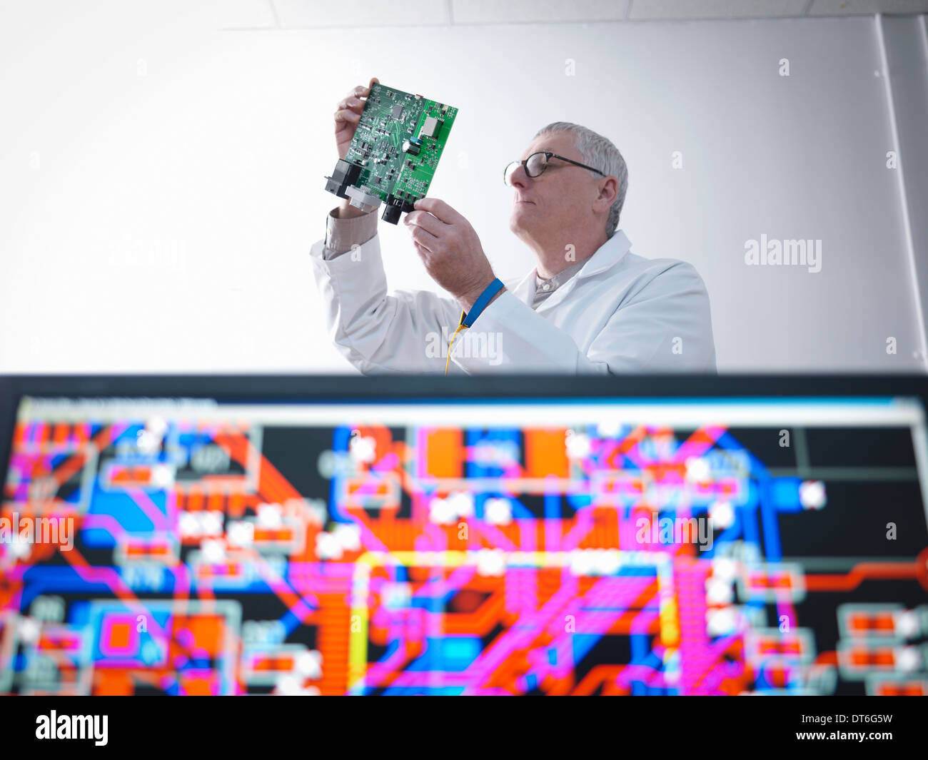 Engineer designing electronic circuitry for automotive use - Stock Image