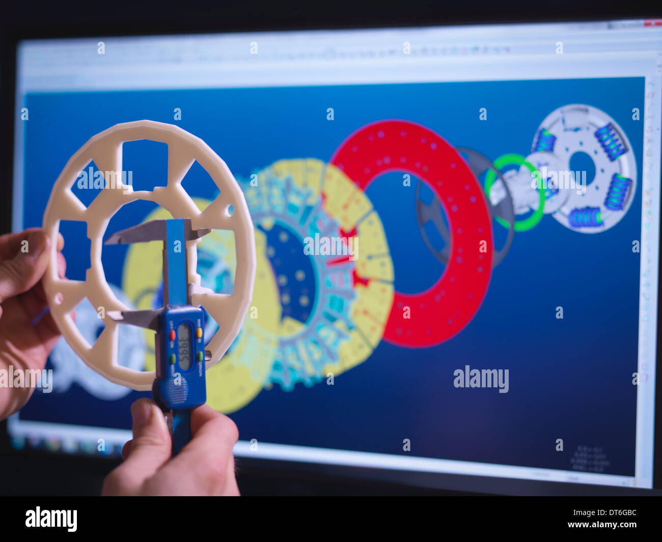 Close up of engineer designing industrial clutch using CAD software - Stock Image