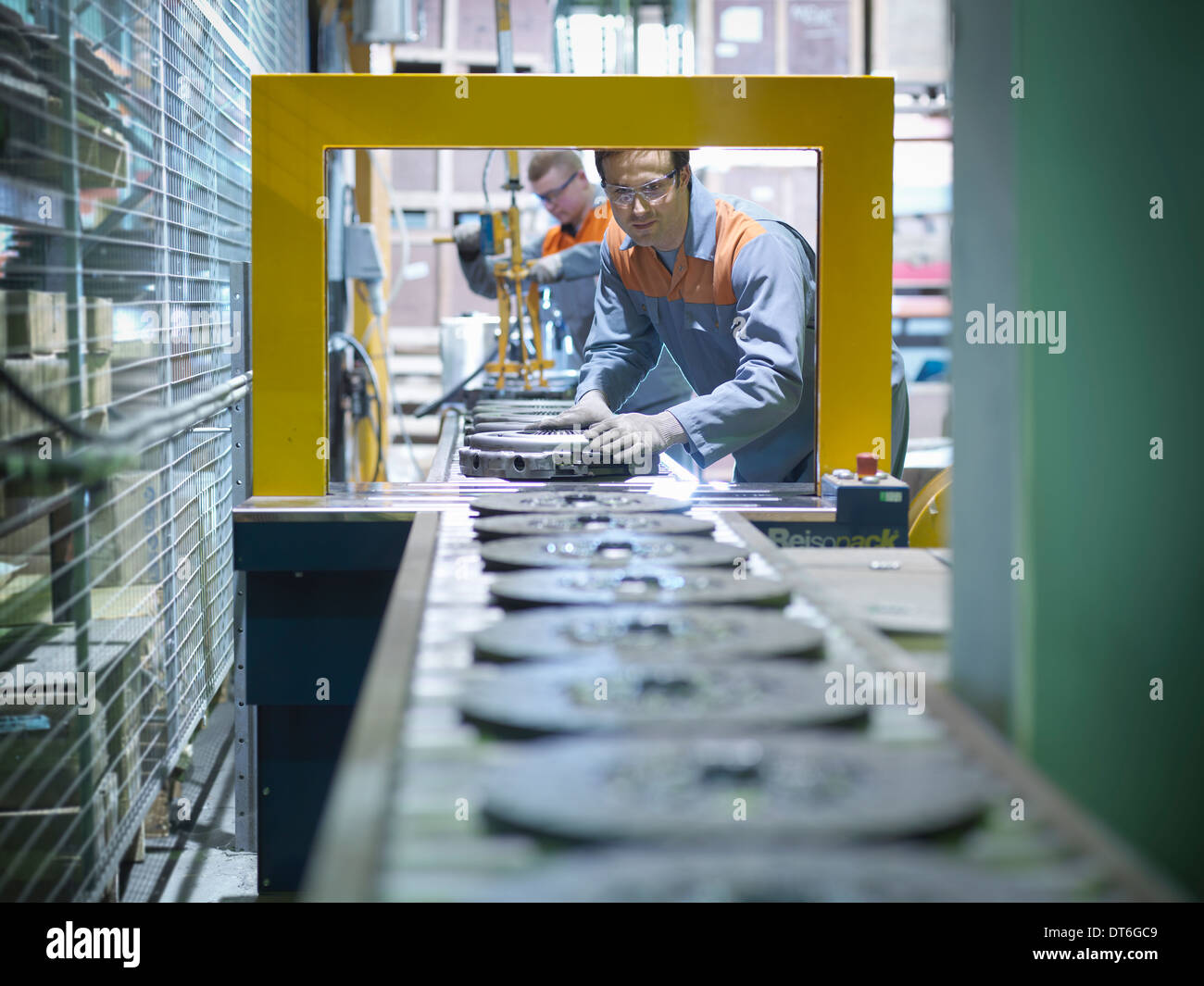 Workers on production line in industrial clutch factory - Stock Image