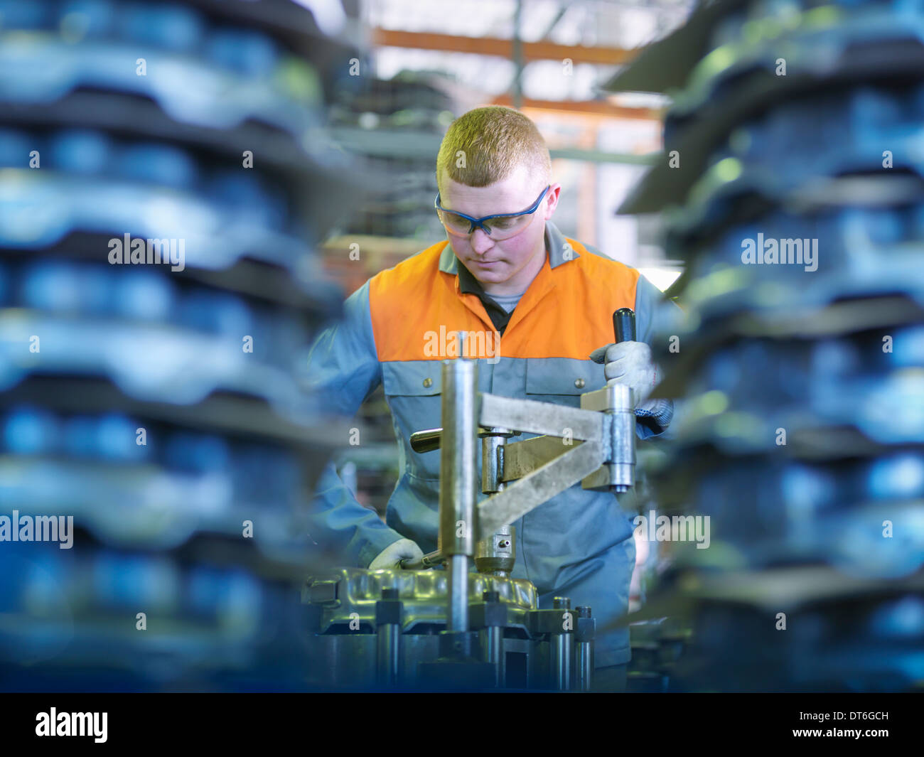 Worker on production line in industrial clutch factory - Stock Image
