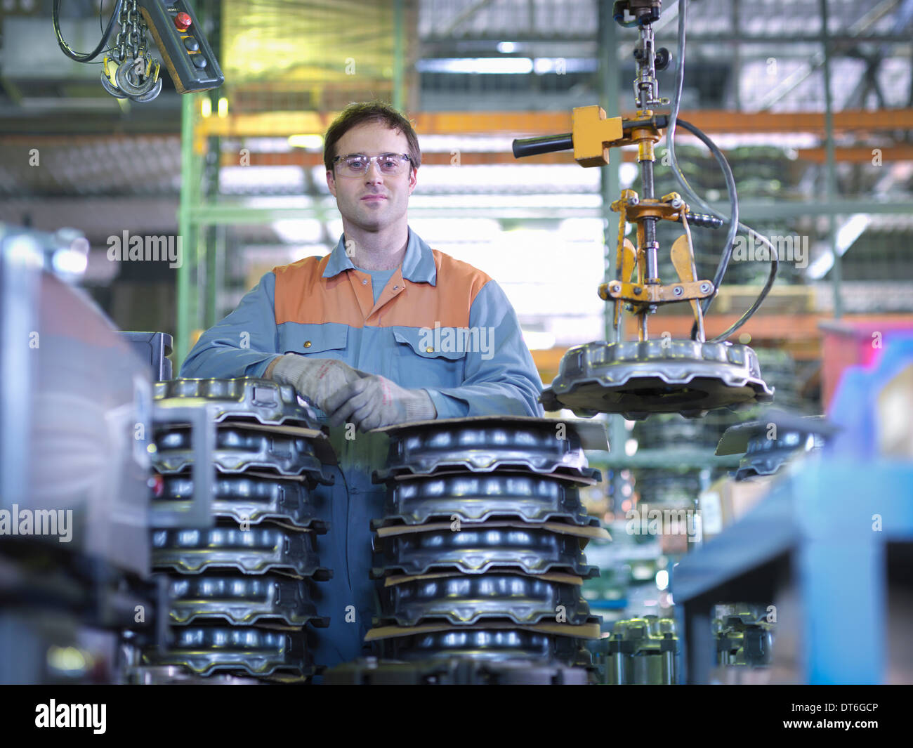 Portrait of worker on production line in industrial clutch factory - Stock Image