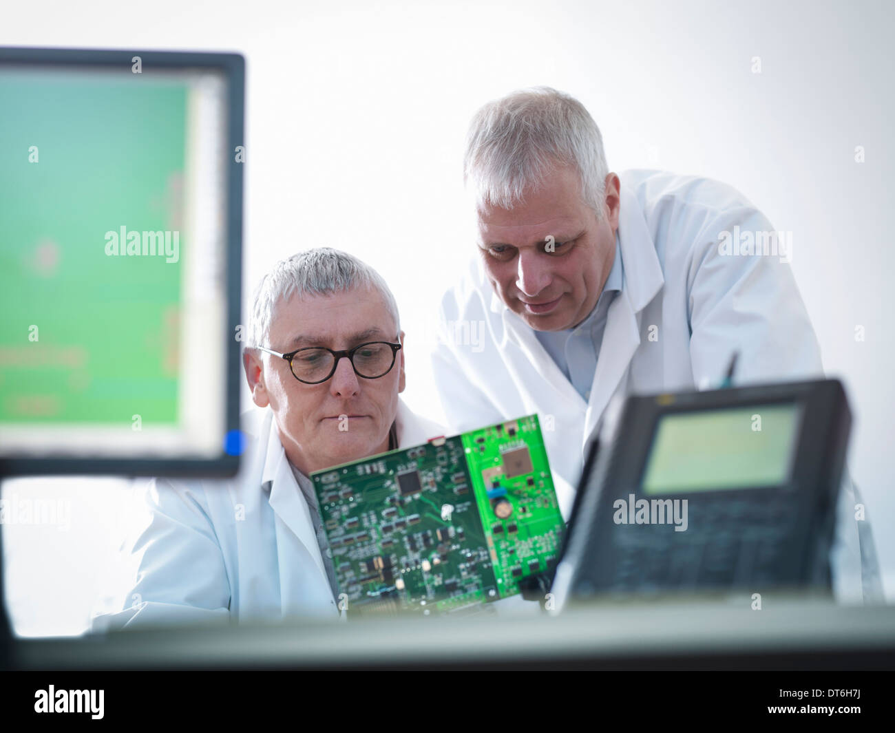 Engineers designing electronic circuitry for automotive use - Stock Image