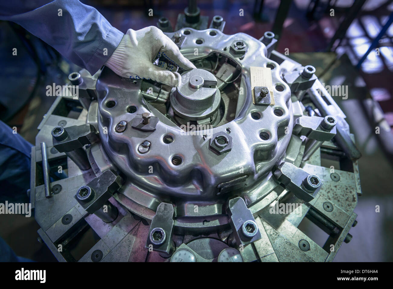 Close up of engineer assembling industrial clutch on production line - Stock Image