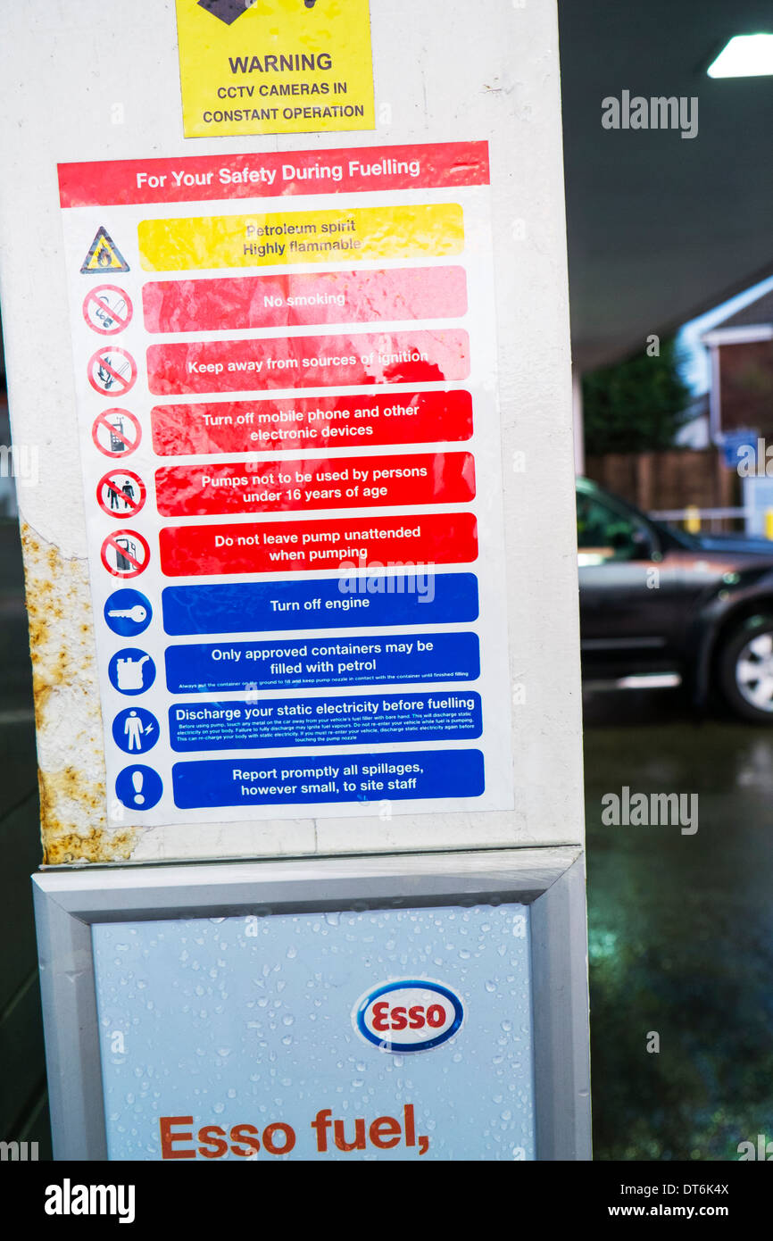 Petrol pump safety sign when refuelling refueling danger warning warnings , UK, England GB - Stock Image