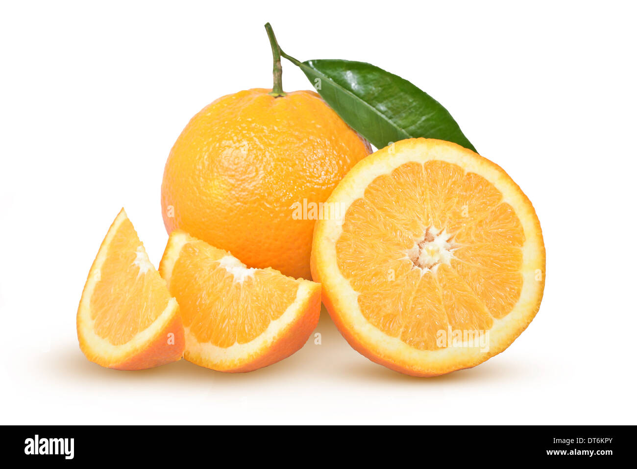 ripe oranges with a green leaf on a white background - Stock Image