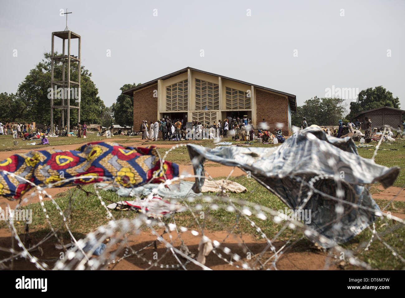 Boali, Bangui, Central African Republic. 9th Feb, 2014. Boali is in the west of Banguy. This sunday christians are going to the church. In front of the church, muslims are refugees. © Laurence Geai/NurPhoto/ZUMAPRESS.com/Alamy Live News - Stock Image