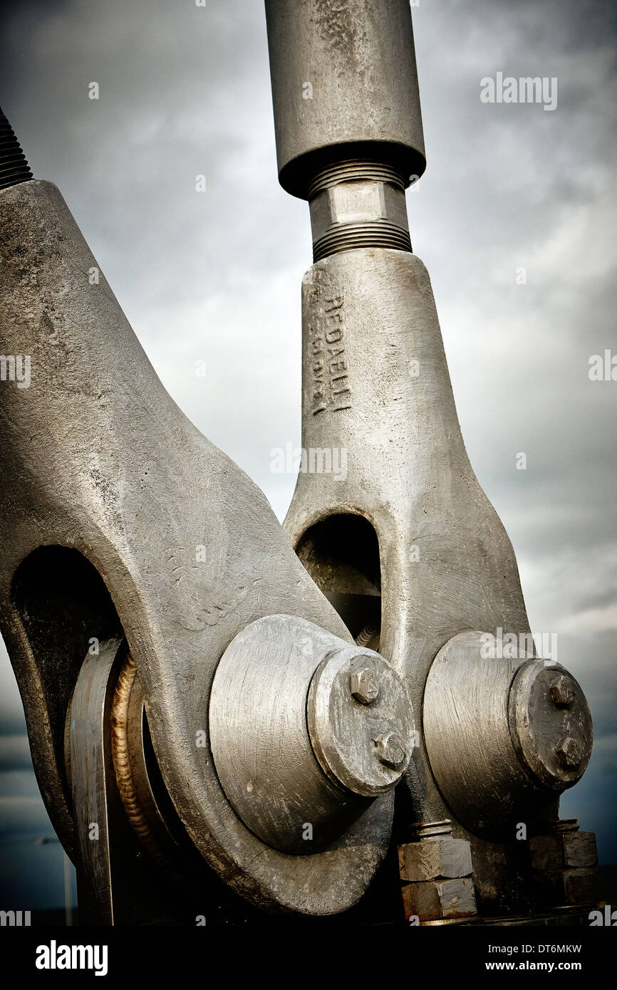Heavy steel fixings for cables supporting a suspension bridge. Stock Photo