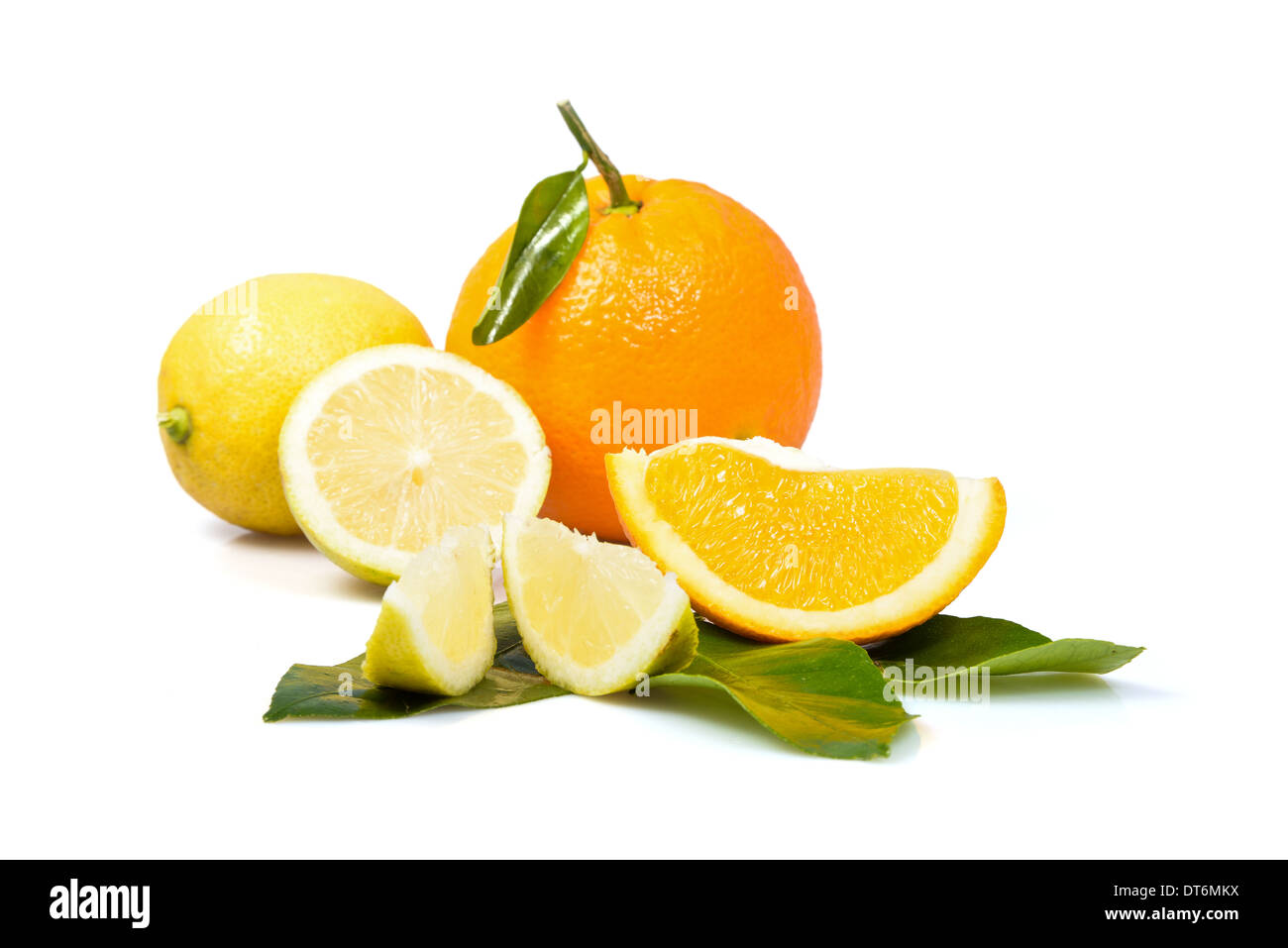 Ripe lemon and oranges with a green leaf on a white background - Stock Image