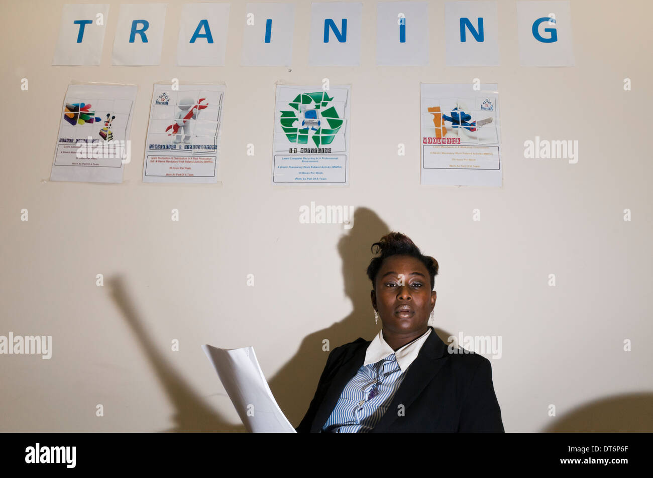 Afro Caribbean woman carrying out training in an office - Stock Image