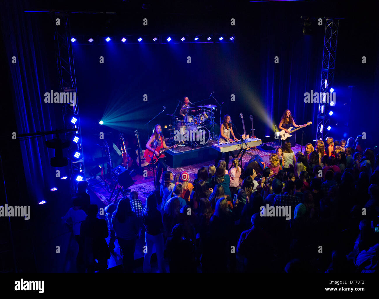 The Red Bandana, a music band of four young girls; play for a music video, SteamPlant Event Center, Salida, Colorado. - Stock Image