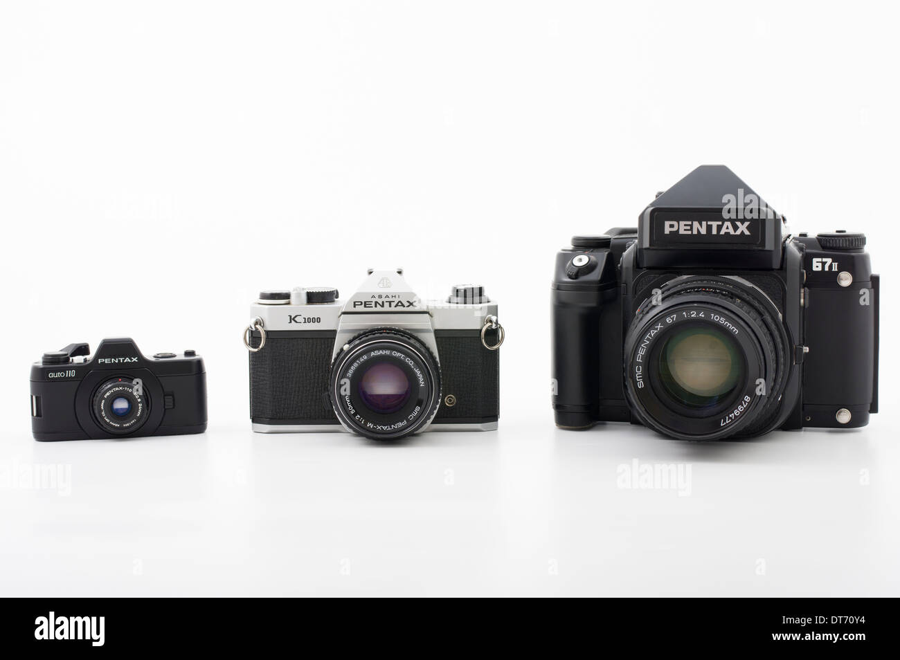 Pentax film SLR cameras in different film formats. 67II medium format, K1000 35mm, Auto110 110 film - Stock Image