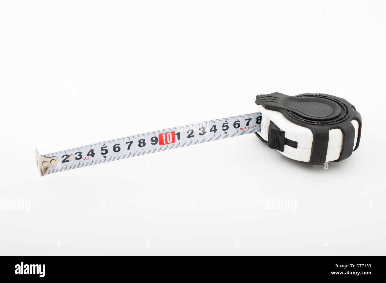 Self-retracting roll-up tape measure ( metric ) a flexible ruler - Stock Image