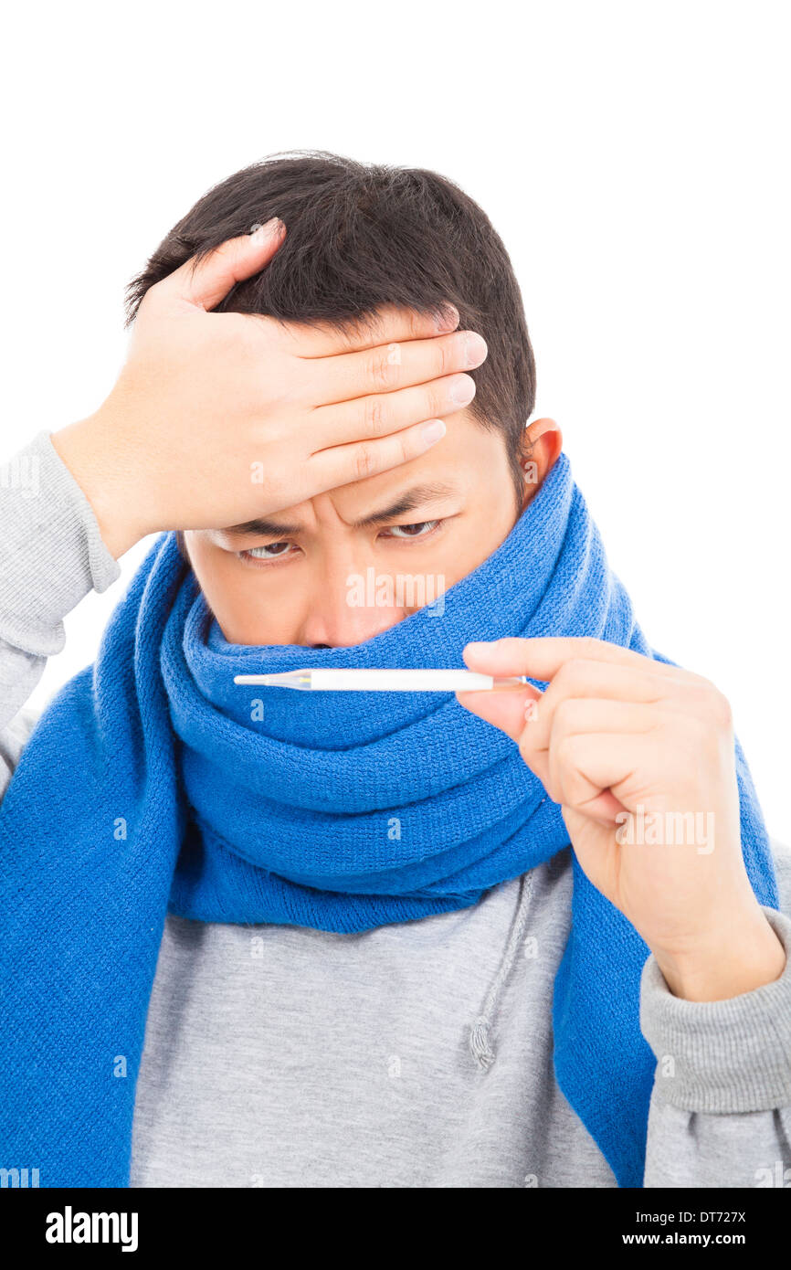 young man with a fever and aching head,painful expression - Stock Image