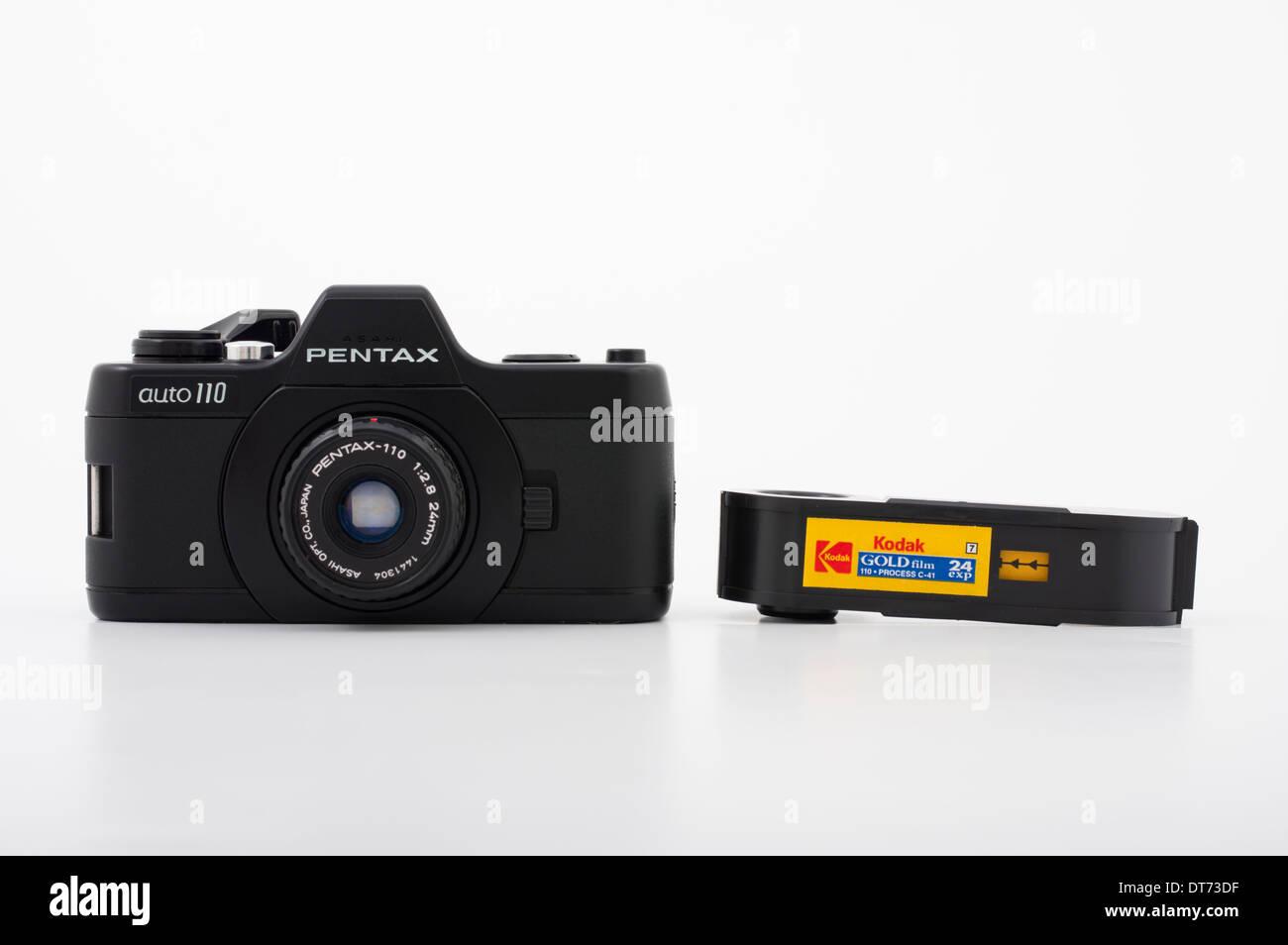 Pentax auto 110 film SLR camera using compact 110 film ( Kodak ) Stock Photo