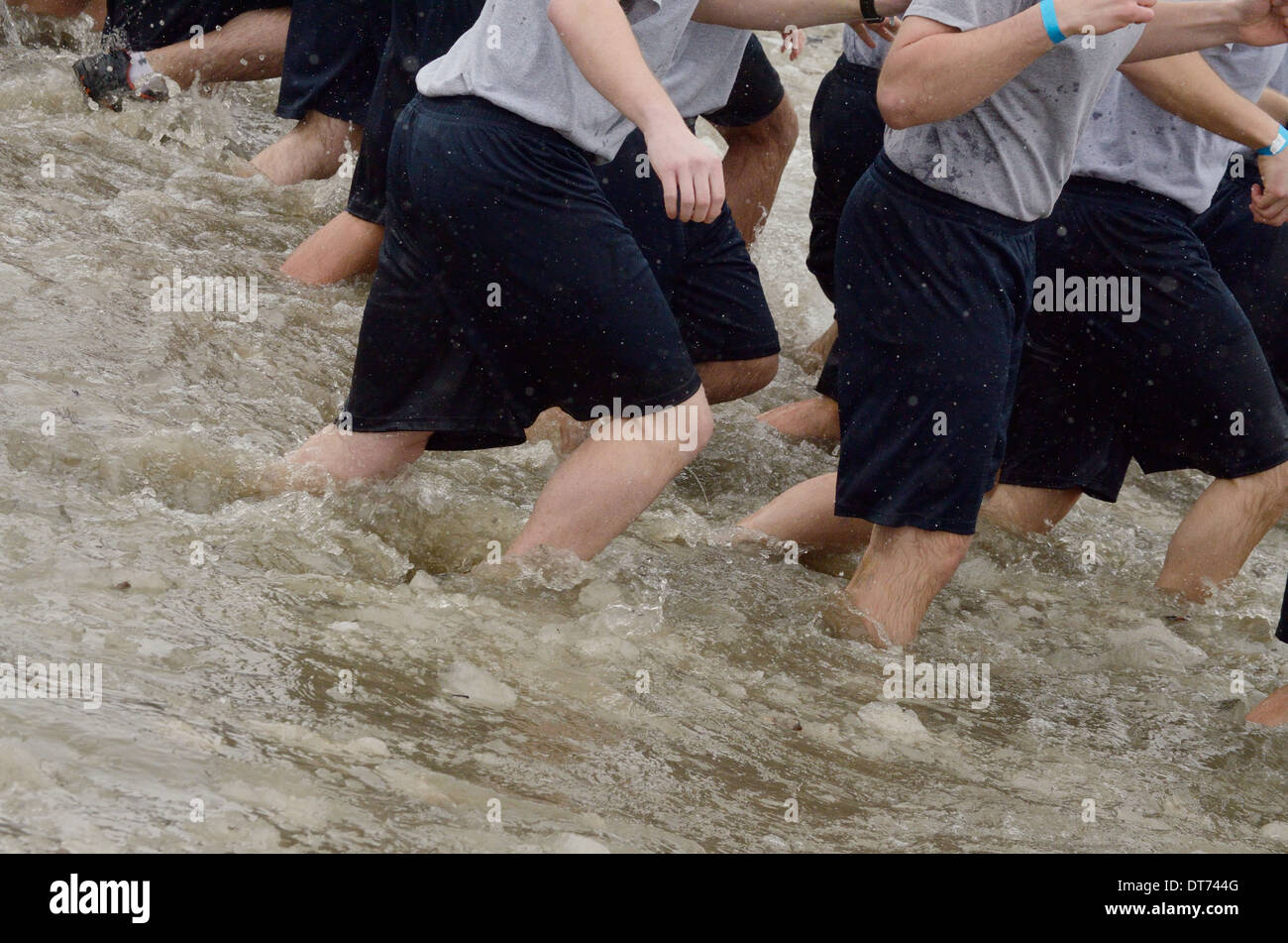 Team participants wear common shorts and shirts in Polar Swim. - Stock Image