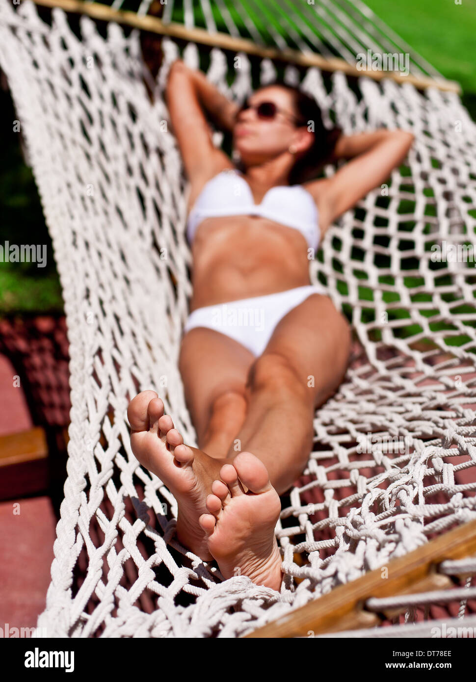 Young woman in hammock. The face in defocus. - Stock Image