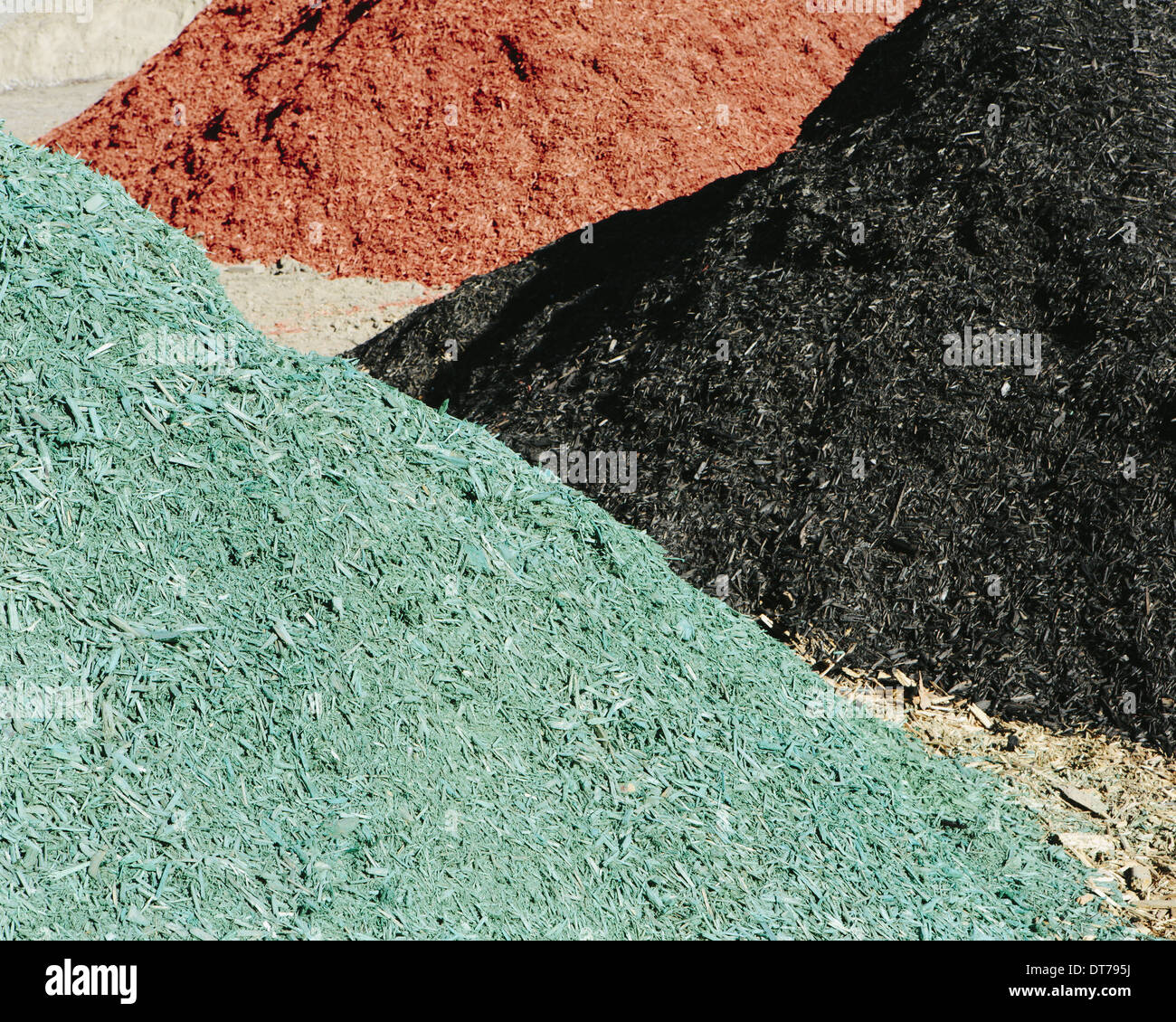 Piles of multi-colored bark wood chips used for landscaping, near Quincy - Stock Image