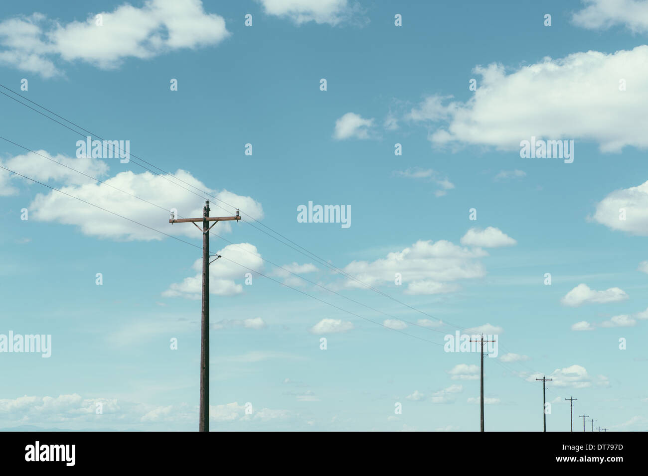 Telephone poles, power lines and cloudy sky, near Quincy - Stock Image