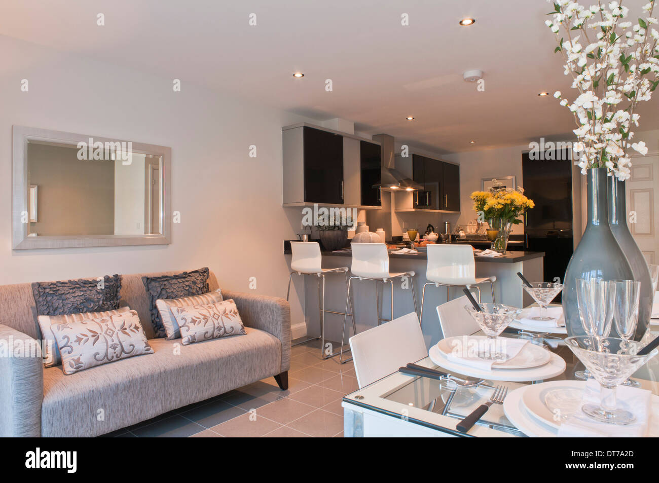 Show home kitchen / diner with sofa Stock Photo - Alamy