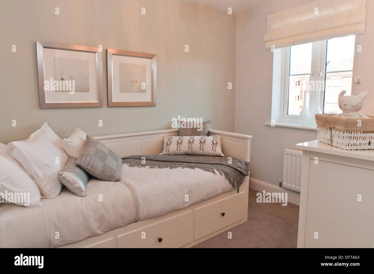 Spare room with sofa bed and neutral decoration Stock Photo - Alamy