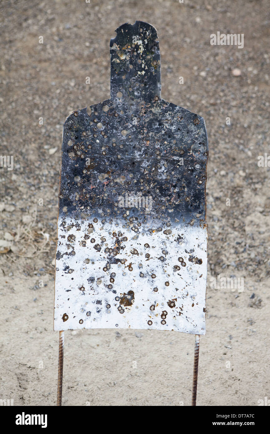 A firing practice target in the shape of a person on a desert firing range in Nevada Elko County Nevada USA - Stock Image