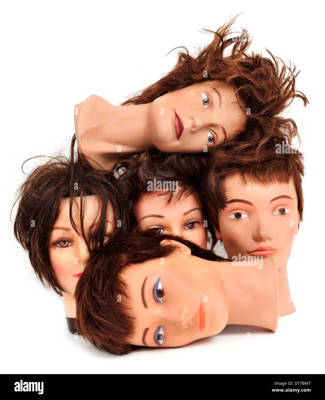 some different mannequin heads on a white background - Stock Image