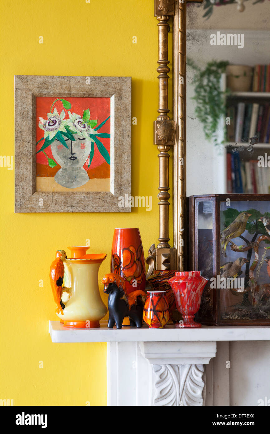 Mantelpiece with Mid Century Modern ceramics (Poole , Eric Leaper, Burleigh) and a Lillian Delevoryas painting. - Stock Image