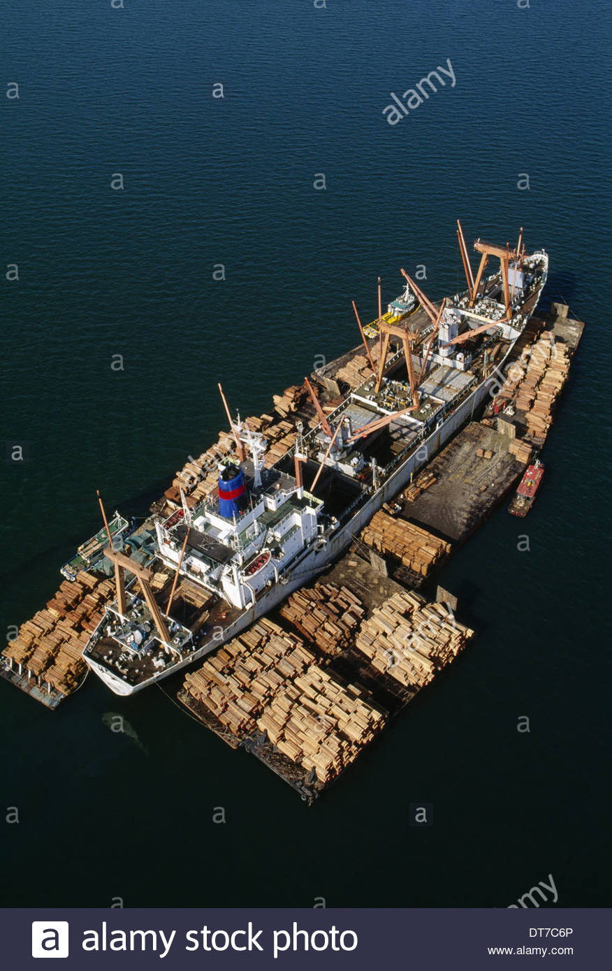 Rainforest lumber loaded on freighter an aerial view of the timber on rafts and on board in Sandakan Borneo Sandakan - Stock Image