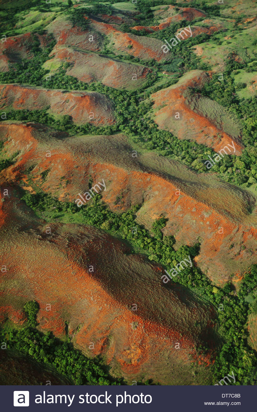 Eroding hills with fragmented forest in valleys An aerial view of an eroding landscape in Western Madagascar Western Madagascar - Stock Image