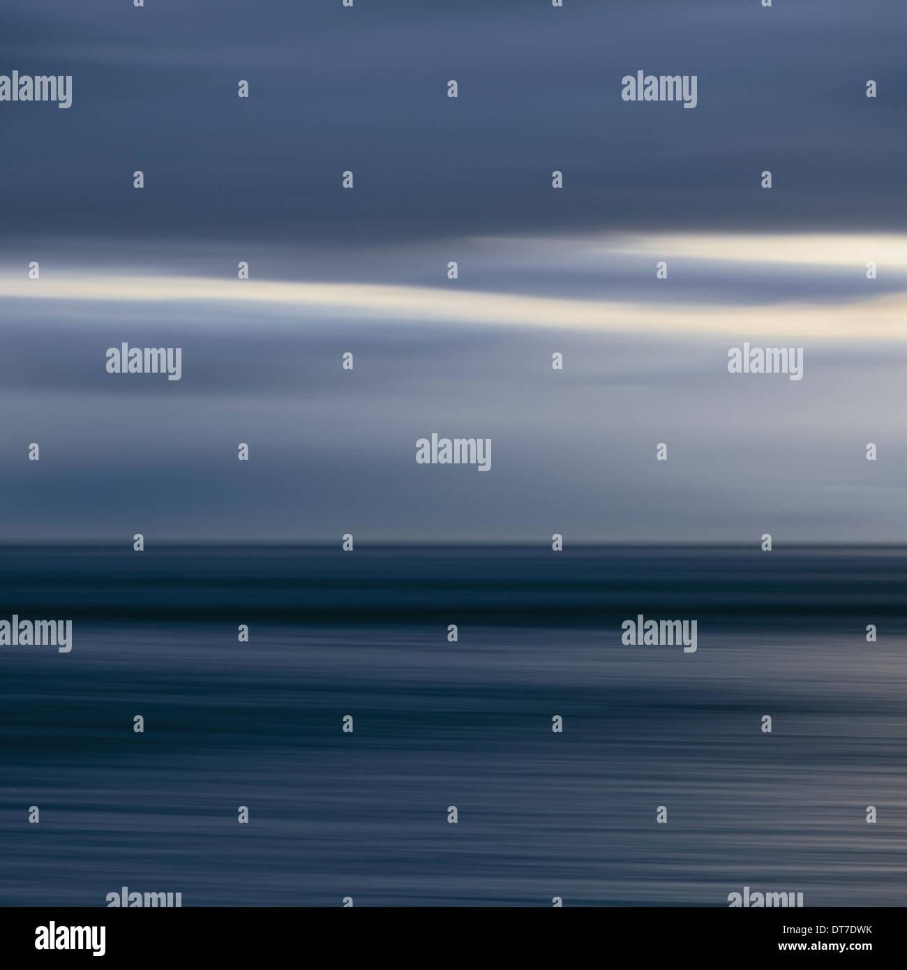 The sea and sky over Puget Sound horizon with light cloud layers above Puget Sound Washington USA Stock Photo