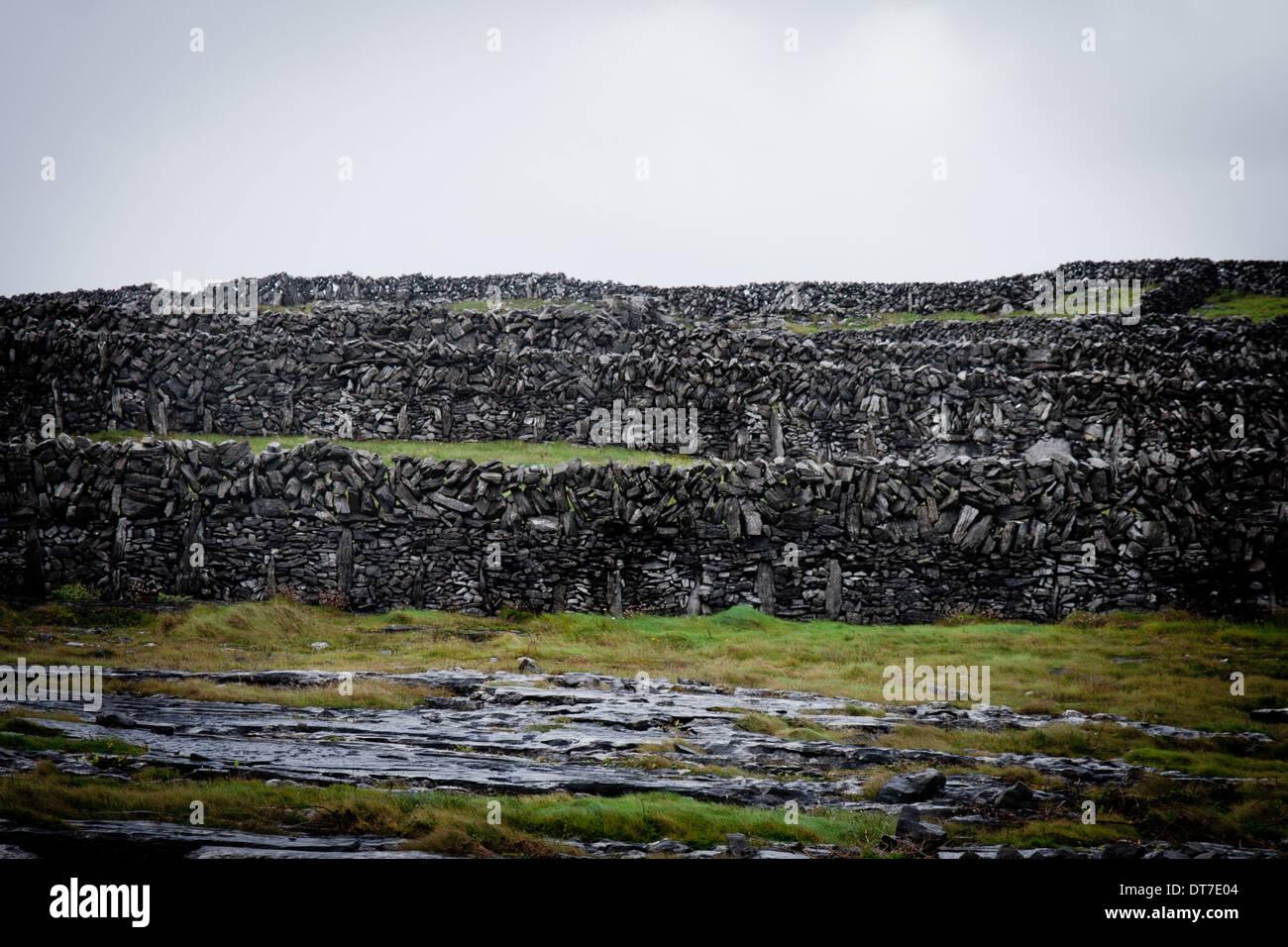 Stone walls fields rainy aran islands ireland galway west - Stock Image